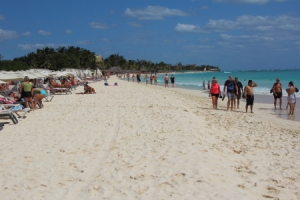 lots of people like to walk along the shores  of the carribean sea