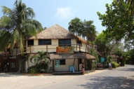 a 2 story beach side hotel on tulum road, There are new luxury hotels in towm but no high rises allowed. The limit is around 2 or 3 stories.