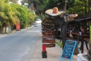 a mexican sombrero and a look down tulum beach road going south