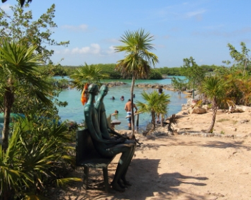this park has a variety of sculptures to see as you walk along a path around the lagoon