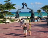 a monument about the Mayan people in playa del carmen on the caribbean sea