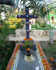 a religious theme for a headstone made with beer bottle caps and quart of corona beer