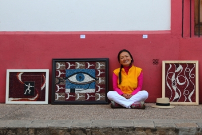 Flora, a local artist from Korea sells her unique style of artwork on Calle Hildago, one of the pedestrian only streets in Centro during the festival