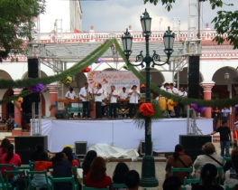 a marimba orchestra performing on one of two stages set up in the main plaza