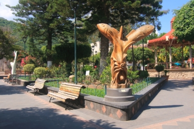 This sculpture is a wood carving at one of the 4 corners of the plaza