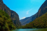 Sumidero Canon is one of the most popular natural wonders in mexico and was carved out by the Grijala River seen here. In some places the ealls are as high as 1000 ft and its 13 kilometers long. There are thirteen rapids, 5 waterfalls, 3 beaches and 2 freshwater springs.