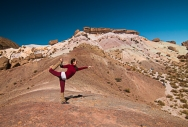 a yoga instructor from Buenos Aires practices her art forms with the hill of 7 colores in the background